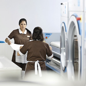 Choosing In House Laundry image by Advanced Laundry Systems, New York's #1 commercial laundry distributor, providing the best commercial laundry equipment, including washing machines, dryers, and laundromat payment systems and ancillary items. We proudly serve laundry businesses throughout greater New York. Advanced Laundry Systems can outfit your NYC laundromat business with the best coin laundry machines, laundromat supplies, and repair services. We also provide on-premises laundry solutions for commercial laundries, hotels, hospitals, restaurants, and more. We distribute Electrolux, Wascomat, Crossover, Dexter, and LG commercial laundry equipment.